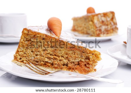 Two pieces of carrot cake on white plates over bright background - stock photo