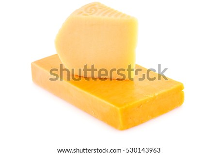 Two pieces of cheese isolated on white background.