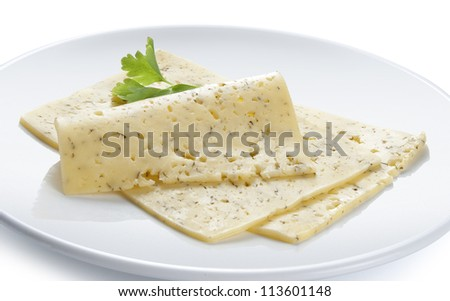 Two pieces of cheese with parsley on the white plate