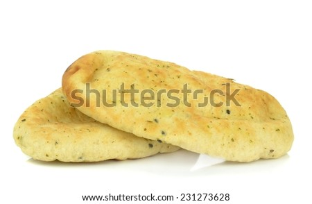 Two pieces of garlic coriander naan bread on a white background - stock photo