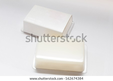 Two pieces of natural Yogurt soap handmade on white background - stock photo