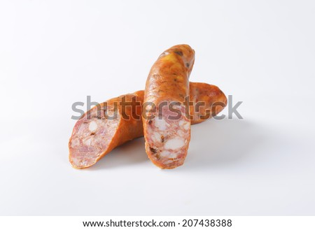 two pieces of pork grilling sausage - stock photo