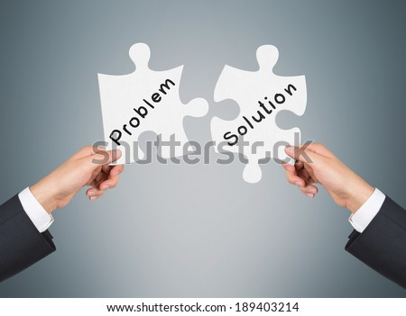 Two pieces of puzzle: Problem and Solution - stock photo