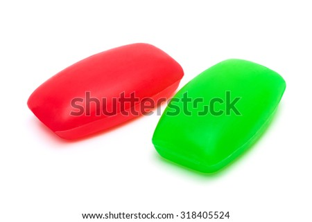 two pieces of soap on a white background - stock photo