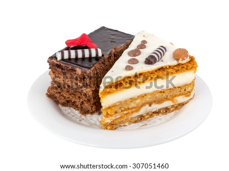 Two pieces of tasty cake on white saucer, chocolate and cream pie - stock photo