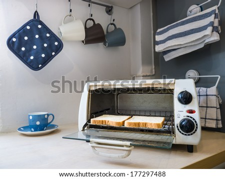 Two pieces of toasts in the oven. - stock photo