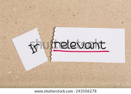 Two pieces of white paper with the word irrelevant turned into relevant - stock photo