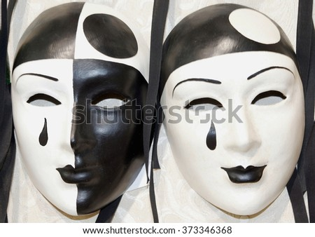 two pierrot masks like ying and yang - stock photo