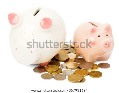 Two piggy banks with coins