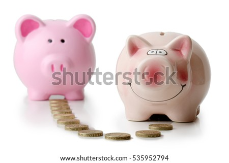 two piggy banks with money transfer concept isolated on a white background