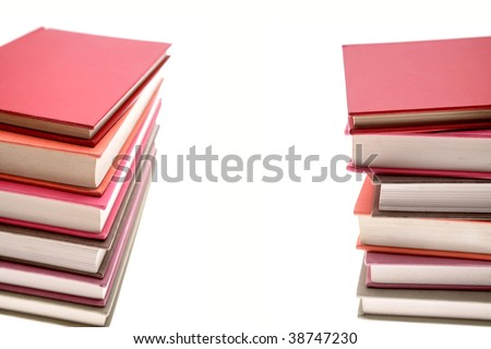 Two piles of books on white background. Copy space