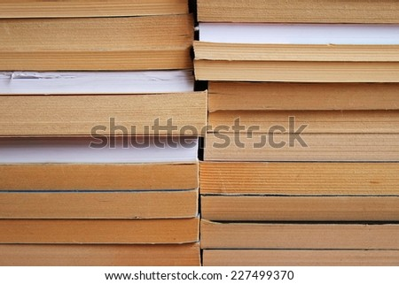 Two piles of books stacked on top of each other - stock photo