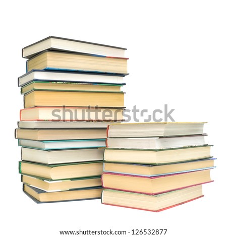two piles of different books isolated on white background