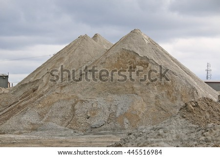 Two piles of stone and sand.