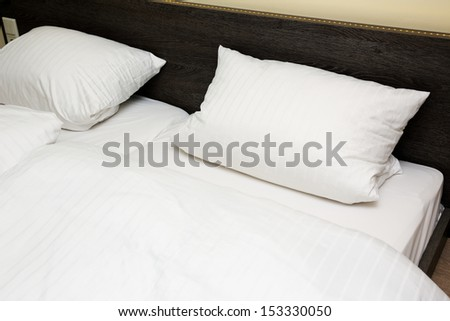 two pillows on the bed - stock photo