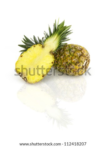 two pineapples on reflective white table