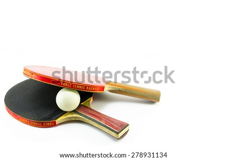 Two ping-pong rackets and a ball isolated on white