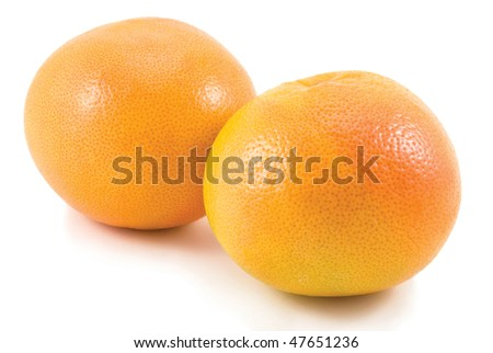 Two pink grapefruits isolated on white background