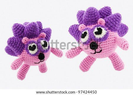 Two pink hedgehogs. Crochet toys. Isolated on white background. - stock photo