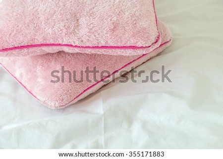 two pink pillows