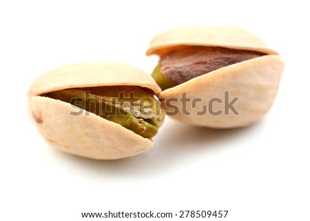 two pistachio nuts on white background