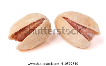 Two pistachios isolated on white background close-up macro - stock photo