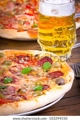 Two pizza and beer - stock photo