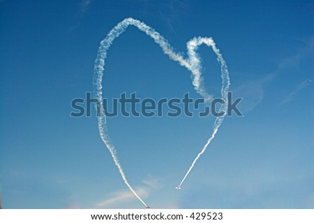 Two planes draw a heart in the sky - stock photo