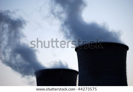 Two plant pipes. Twilight. - stock photo