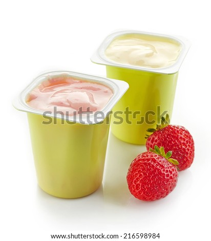 two plastic yogurt pots isolated on a white background