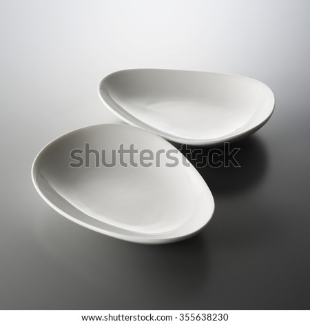two plates on the table. - stock photo