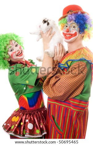 Two playful clown with a white rabbit. Isolated - stock photo