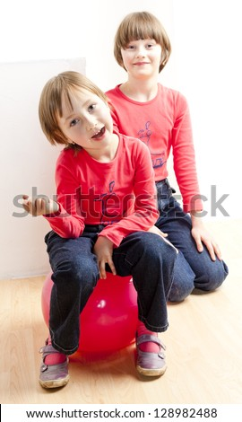 two playing sisters - stock photo