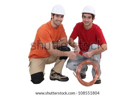 Two plumbers - stock photo