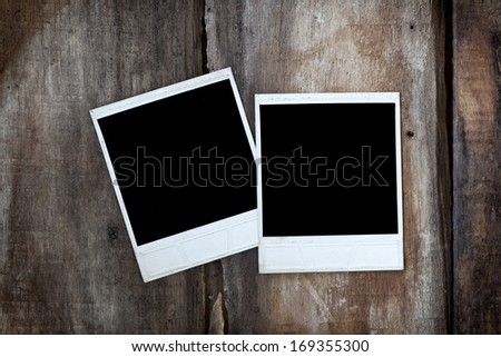 two polaroid vintage photos on old wood  - stock photo
