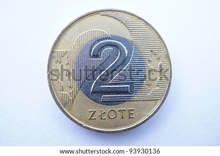 Two polish zloty against a white background