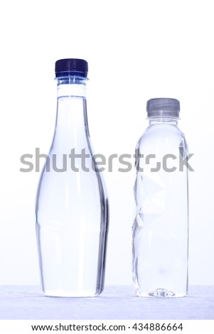 Two Polyethylene Plastic bottle of water isolated on a white background - stock photo