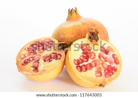 two pomegranate fruits cutout isolated on white