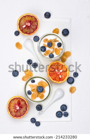 Two portions of yogurt for breakfast - stock photo