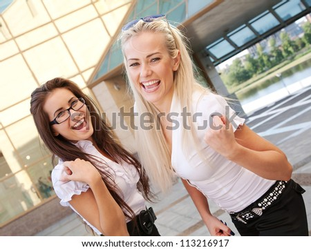 two positive students showing success