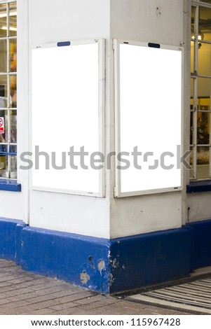 Two posters on corner - stock photo
