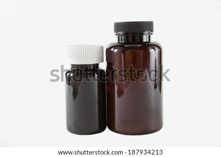 Two prescription bottles against a white background