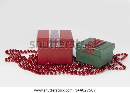 Two presents, red and green, with ribbons, isolated on white background