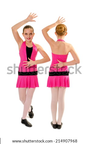 Two Preteen Girls in Pink Costume Posing in Jazz Dance Style Duet