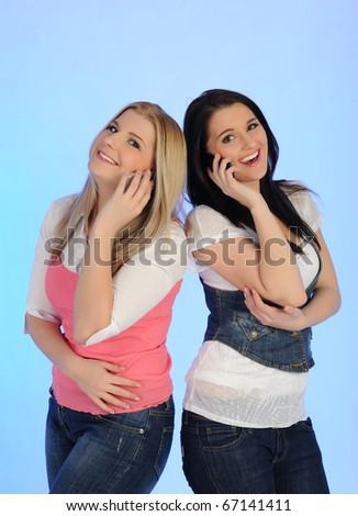 two Pretty casual woman speaking on the phone - stock photo