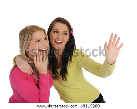 Two pretty girl friends having fun and laughing. isolated on white background - stock photo