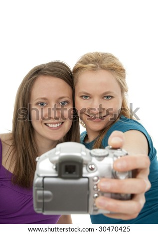 Two pretty girls posing for a camera and having fun. - stock photo