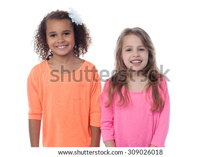 Two pretty little girls posing together - stock photo