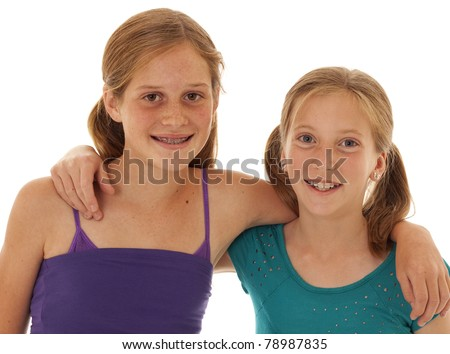 two pretty little girls post for a picture - stock photo