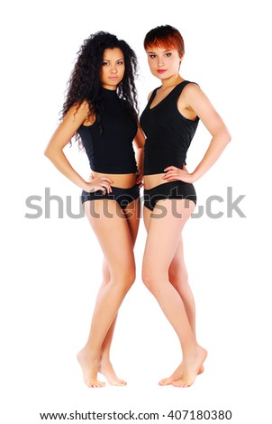 Two pretty woman in black lingerie on white background. Lesbian couple.